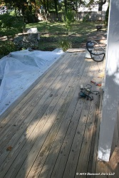 The pressure treated wood next to the koi pond did not have paint on it. It was cleaned, sanded and buffed.