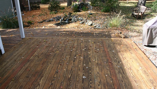 Another view of the deck one day later after the oil has sunk in.