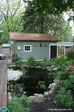 This is the koi pond shown 7 months after the deck was done. We had come back to clean and restore their cedar shake roof.
