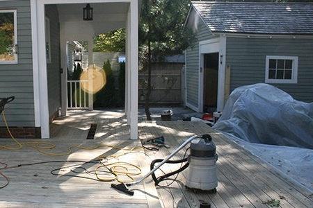 Another view of the sanding and buffing stage of restoring this deck.