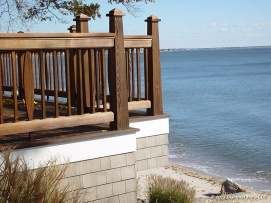 Custom cedar railing in medium brown oil.