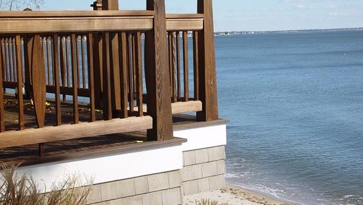 Custom cedar railing in medium brown oil.
