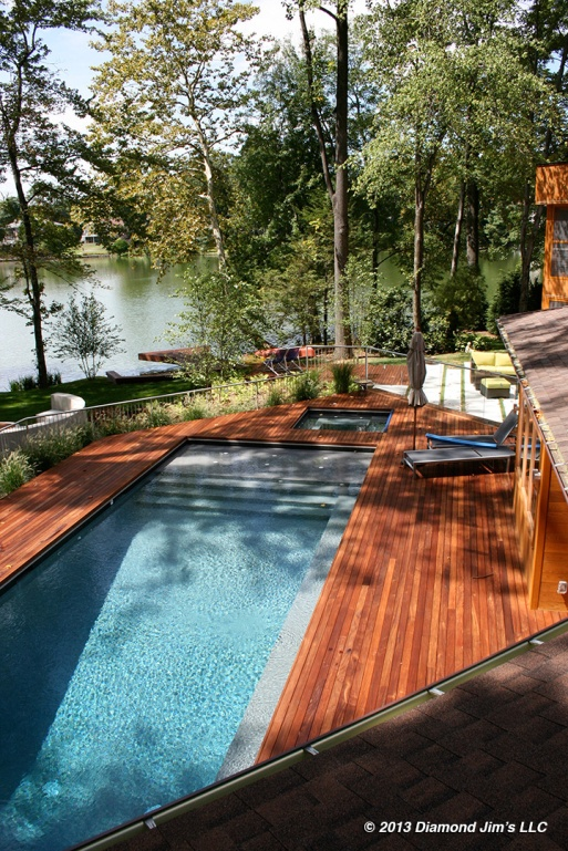 Ipé deck around pool in medium red pigment.