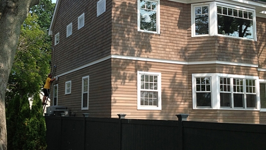 Western red cedar clapboard and shake restored in dove gray penetrating oil.