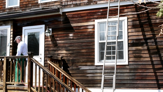 Chemical solution applied to cedar clapboards during the cleaning process.