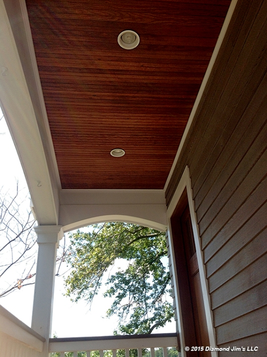 The cedar porch ceiling beadboard and overhangs were oiled in a light brown penetrating oil to complement the dove gray.